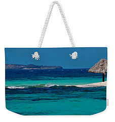 Weekender Tote Bag featuring the photograph Tropical Umbrella by Don Schwartz