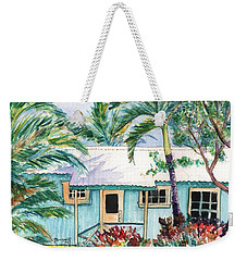Weekender Tote Bag featuring the painting Tropical Vacation Cottage by Marionette Taboniar