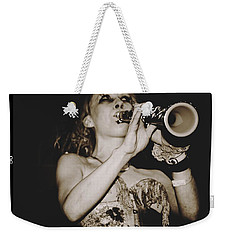 Weekender Tote Bag featuring the photograph Trumpet Lady by Alice Gipson