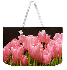 Weekender Tote Bag featuring the photograph Tulips In Bloom by Lingfai Leung