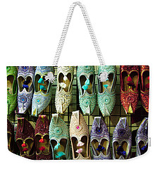Weekender Tote Bag featuring the photograph Tunisian Shoes by Donna Corless