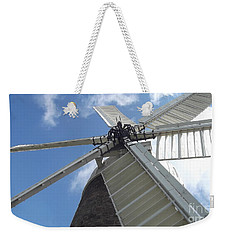 Weekender Tote Bag featuring the photograph Turning In The Wind by Tracey Williams