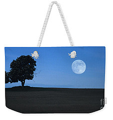 Weekender Tote Bag featuring the photograph Twilight Solitude by Sharon Elliott