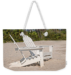Weekender Tote Bag featuring the photograph Two Beach Chairs by Charles Beeler