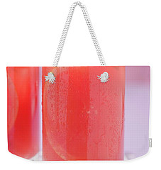 Two Glasses Of Pink Grapefruit Juice With Ice Cubes Weekender Tote Bag