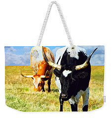 Weekender Tote Bag featuring the painting Two Longhorns Grazing by Ann Powell