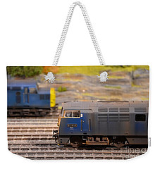 Weekender Tote Bag featuring the photograph Two Yellow Blue British Rail Model Railway Train Engines by Imran Ahmed