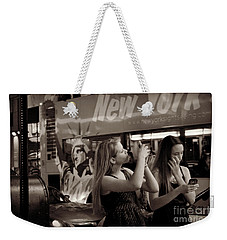 Weekender Tote Bag featuring the photograph Girls With Phones And Tourbus - Times Square by Miriam Danar
