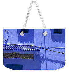 Weekender Tote Bag featuring the photograph Typical Blue Facade In The Medina Of Asilah On Northwest Tip Of Atlantic Coast Of Morocco by Ralph A  Ledergerber-Photography