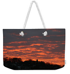 Weekender Tote Bag featuring the photograph Under A Blood Red Sky by Neal Eslinger