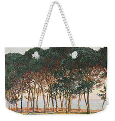 Under The Pines. Evening Weekender Tote Bag by Claude Monet