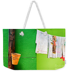 Weekender Tote Bag featuring the photograph Vase Towels And Green Wall by Silvia Ganora