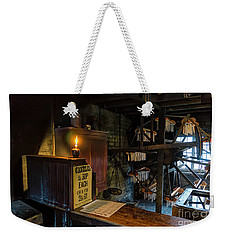 Weekender Tote Bag featuring the photograph Victorian Candle Factory by Adrian Evans