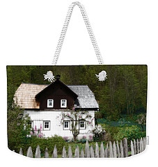 Weekender Tote Bag featuring the photograph Vine Covered Cottage With Rustic Wooden Picket Fence by Brooke T Ryan