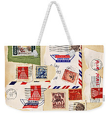 Weekender Tote Bag featuring the photograph Vintage Stamps On Old Postcard by Vizual Studio