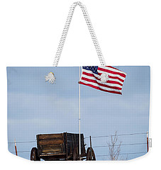 Weekender Tote Bag featuring the photograph Wagon And Flag by Michael Chatt