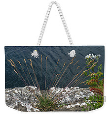 Weekender Tote Bag featuring the photograph Flowers In Rock by Brenda Brown