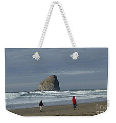 Weekender Tote Bag featuring the photograph Walking On The Beach by Susan Garren