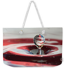 Weekender Tote Bag featuring the photograph Water Drops Jumping by Jeff Folger