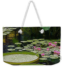 Weekender Tote Bag featuring the photograph Water Lilies And Platters And Lotus Leaves by Byron Varvarigos