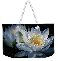 Weekender Tote Bag featuring the photograph Water Lilies In White by Julie Palencia