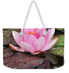 Weekender Tote Bag featuring the photograph Water Lily by Simona Ghidini