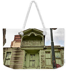 Weekender Tote Bag featuring the photograph Weathered Old Green Wooden House by Imran Ahmed