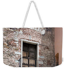 Weekender Tote Bag featuring the photograph Weathered Wooden Church Doors by Lynn Palmer