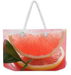 Wedge Of Pink Grapefruit On Slice Of Grapefruit With Leaf Weekender Tote Bag