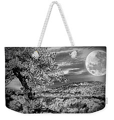 Weekender Tote Bag featuring the photograph When The Moon Comes Over Da Mountain by Robert McCubbin