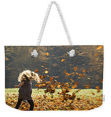 Weekender Tote Bag featuring the photograph Whirling With Leaves by Carol Lynn Coronios