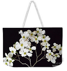 Weekender Tote Bag featuring the photograph White Dogwood Branch by Jeannie Rhode