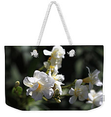 Weekender Tote Bag featuring the photograph White Flower - Early Spring Time by Ramabhadran Thirupattur