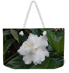 Weekender Tote Bag featuring the photograph White Flower by Sergey Lukashin