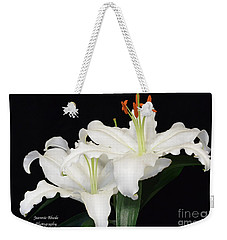 Weekender Tote Bag featuring the photograph White  Lilies by Jeannie Rhode