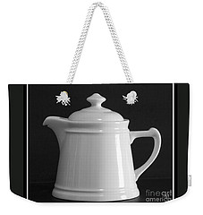 Weekender Tote Bag featuring the photograph White On Black by Victoria Harrington
