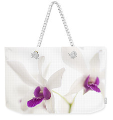 Weekender Tote Bag featuring the photograph White Orchids by Bradley R Youngberg