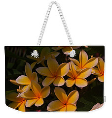 Weekender Tote Bag featuring the photograph White Plumeria by Miguel Winterpacht