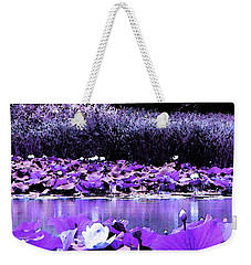 Weekender Tote Bag featuring the photograph White Water Lotus In Violet by Shawna Rowe