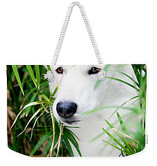 Weekender Tote Bag featuring the photograph White Wolf by Erika Weber