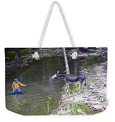 Weekender Tote Bag featuring the photograph Who Is More Stubborn by John Glass