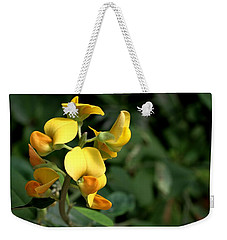 Weekender Tote Bag featuring the photograph Wild Bonanza by Ramabhadran Thirupattur