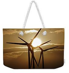 Wind Turbines Silhouette Against A Sunset Weekender Tote Bag