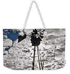 Weekender Tote Bag featuring the digital art Windmill In The Clouds by Cathy Anderson