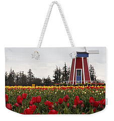 Weekender Tote Bag featuring the photograph Windmill Red Tulips by Athena Mckinzie