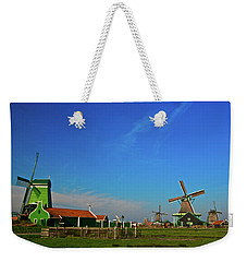 Weekender Tote Bag featuring the photograph Windmills At Zaanse Schans by Jonah  Anderson