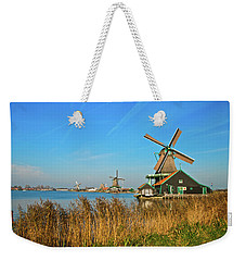 Weekender Tote Bag featuring the photograph Windmills On De Zaan by Jonah  Anderson