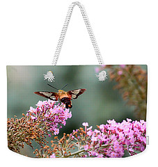 Weekender Tote Bag featuring the photograph Wings In The Flowers by Kerri Farley