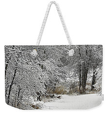 Weekender Tote Bag featuring the photograph Winter's Kiss by Don Schwartz