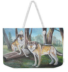 Weekender Tote Bag featuring the painting Wolves In The Forest by Thomas J Herring